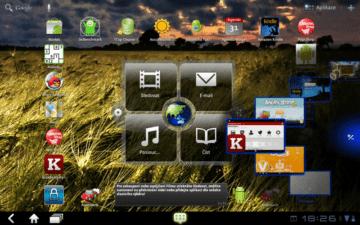 Tlačítkem uprostřed dolní lišty vyvoláte menu se šesti aplikacemi, které si označíte jako oblíbené.
