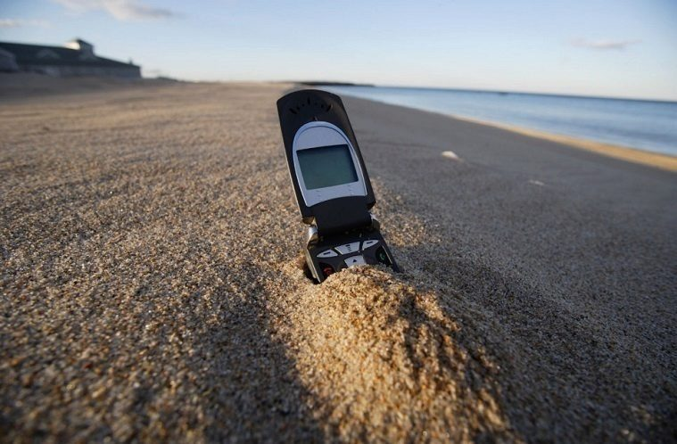 Cell phone in sand on Beach